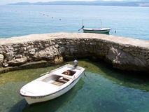 Boats at the rocky pier in Croatia. Two boats moored at the pier in Omis, Croatia Stock Photography