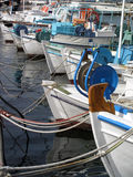Boats in a row. Fishing boats in Greece lined up at a dock Stock Images