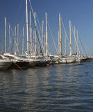 Boats in a row. Beautiful blue sky behind a row of yatchs royalty free stock photo