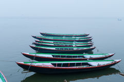 Boats in a row on sacred river Ganges foggy morning. Varanasi Stock Images