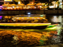Boats rush in night canals. Stock Images