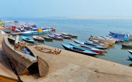 Boats on sacred river Ganges foggy morning. Varanasi Stock Image
