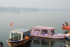 Boats on the sacred river Narmada at Maheshwar Stock Images