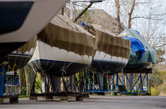 Boats safe for the winter. Boats in a Michigan harbor are dry docked and wrapped to protect them from the harsh cold winters Royalty Free Stock Photography