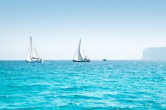 Boats sail regatta with sailboats in mediterranean Stock Image