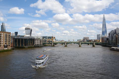 Boats sail the River Thames in London, England Stock Photos
