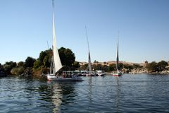 Boats sailing in Aswan river nile. In Egypt with great water color and landscape Stock Images