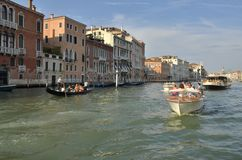 Boats sailing by the Grand Canal Royalty Free Stock Images