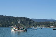 The ocean with boats in the blue sea. l royalty free stock photos