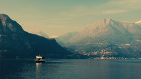 Boats sailing through a mountain lake. Lake Como, Italy. Boats sailing through a mountain lake. Lake Como, Italy, February stock footage