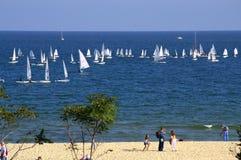 Boats sailing off beach Stock Photos