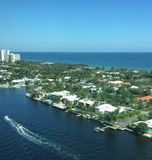 Boats Sailing Past a Community in the Intracoastal Stock Image