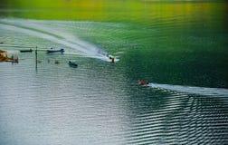 The boats are sailing in the river at Khun Dan Prakan Chon Dam stock photography