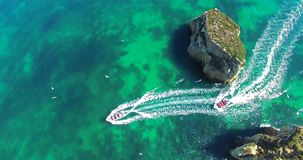 Boats sailing between the rocks aerial stock footage