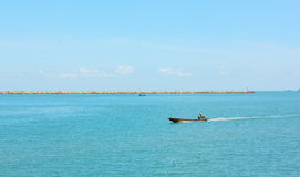boats are sailing on the sea background in the noon time. Stock Photography