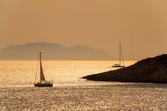 Boats Sailing at Sunset, Hvar Croatia. Silhouettes of yachts or boats sailing at sunset, Hvar, Croatia, Europe Stock Photo