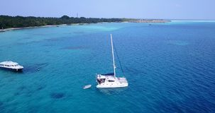 V13297 boats and sailing yachts with view from aerial flying drone in clear aqua blue sea water and blue sky Royalty Free Stock Photography