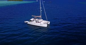V13317 boats and sailing yachts with view from aerial flying drone in clear aqua blue sea water and blue sky Stock Photos