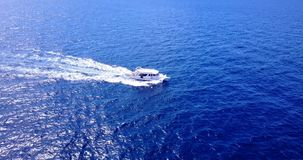 V14402 boats and sailing yachts with view from aerial flying drone in clear aqua blue sea water and blue sky Stock Image