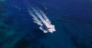 V13334 boats and sailing yachts with view from aerial flying drone in clear aqua blue sea water and blue sky Royalty Free Stock Photo