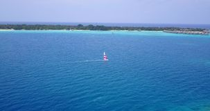 V15031 boats and sailing yachts with view from aerial flying drone in clear aqua blue sea water and blue sky Royalty Free Stock Image