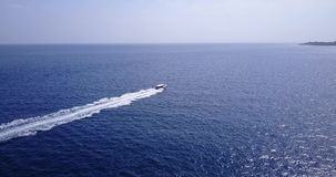 V15058 boats and sailing yachts with view from aerial flying drone in clear aqua blue sea water and blue sky Stock Images