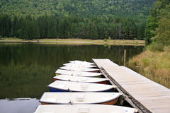 Boats on the saint ana volcanic lake, romania. View of boats floating on the saint ana volcanic lake, romania Stock Image