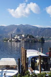 Boats and Saint Giulio island on Orta lake Royalty Free Stock Images