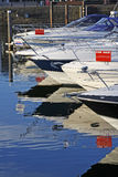 Boats for sale. Motorboats and yachts for sale, moored in a marina royalty free stock photo