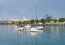 Boats at San Juan Bay, Puerto Rico. Sailboats anchored in the bay at San Juan. Old city buildings in background stock photography