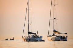 Boats sanchored at sunset Stock Photo