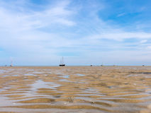 Boats on sand flats Wadden Sea, Netherlands stock photos