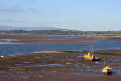 Boats on sand, low tide, looking towards Hest Bank Royalty Free Stock Photography
