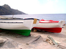 Boats on sandbank. Two coloured typical fishing boats on a sandbank in Pantelleria island (Sicily Royalty Free Stock Images