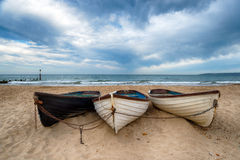 Boats On A Sandy Beach Royalty Free Stock Photos
