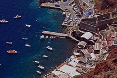 Boats in Santorini harbor Stock Images