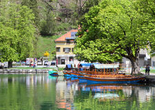 Boats and scenery at Lake Bled Royalty Free Stock Photography