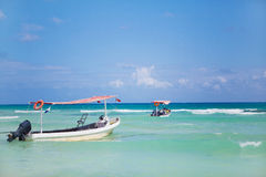 Boats in the sea. Old boats waiting for passengers sailing in Caribbean sea in Mexico Stock Images