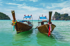Boats at sea against the rocks in Thailand Stock Images