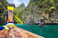 Boats at sea against the rocks in Thailand Stock Image