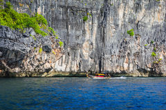 Boats at sea against the rocks in Thailand Royalty Free Stock Photo