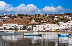 Boats in the sea bay near the town of Mykonos in Greece against Stock Photos