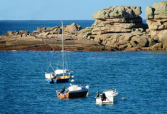 Boats in the sea bay with rocks Stock Image