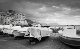 Boats by the sea, black and white photo. Stock Photo