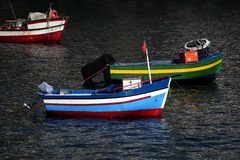 Old colored, traditional boats at the coast of Madeira Royalty Free Stock Images