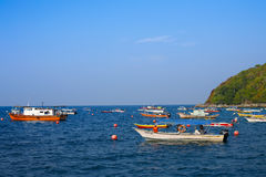Boats at sea. Fishing boats moored of the coast of Pulau Perhentian in Terengganu Royalty Free Stock Image