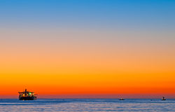Boats by the sea at sunset Royalty Free Stock Photography