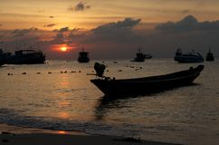 Boats in the sea at sunset Royalty Free Stock Photography