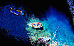 Boats on sea surface. Bird`s eye view of boats on crystal clear sea surface, Greece stock image