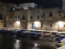 Boats in seaport in Monopoli stock photography